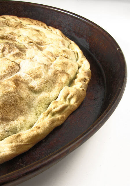 The crust of a torta verde, an Italian savory pie. This one is filled with chard, potatoes and feta.