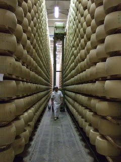 Photo of Parmigiano Reggiano aging room by Scott Brenner on Flickr