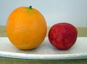 Normal navel orange and tiny blood orange
