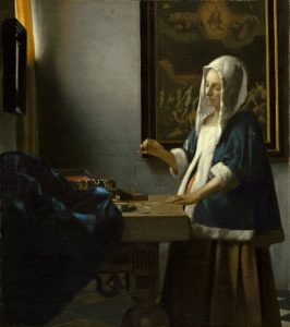 Vermeer painting of woman holding a balance