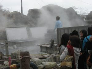 Unloading cooked eggs from the hot springs at Owakudani