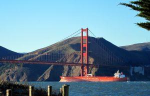 Orange ship and Golden Gate Bridge