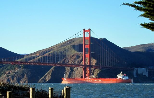 Orange ship and Golden Gate Bridge