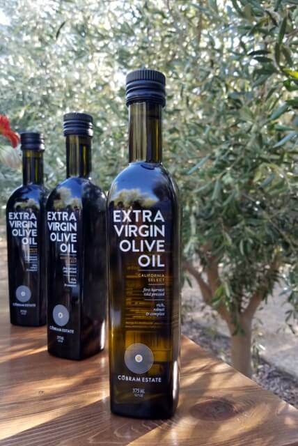 Extra virgin olive oil bottles in the olive grove