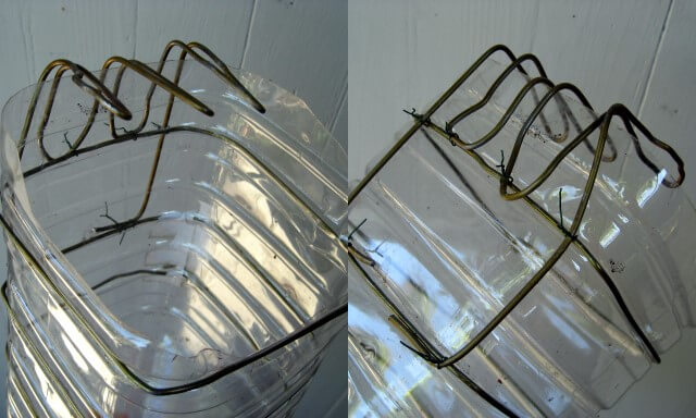 The fingers on the DIY fruit picker made from water bottle and wire hangers